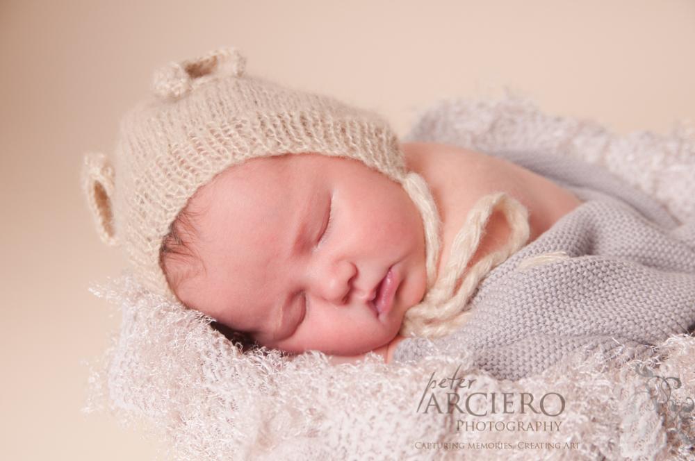 A sleepy newborn baby photo